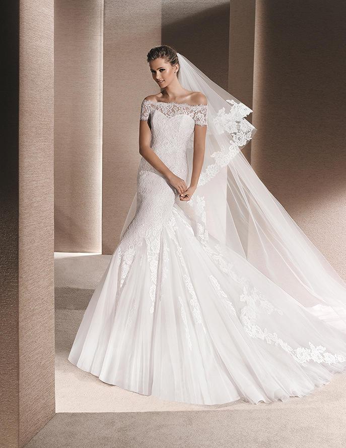 Hombros descubiertos gracias a un vestido de novia como ésta