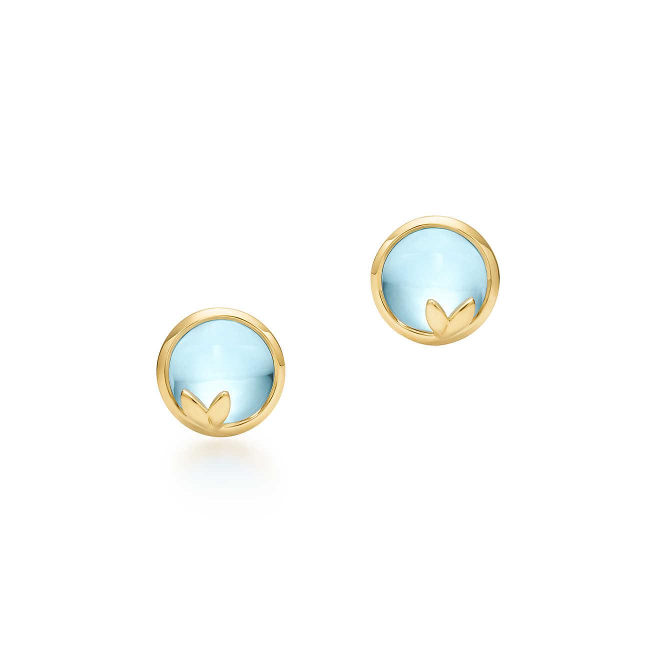 El dorado y el azul hacen una combinación perfecta para estos pendientes de novia