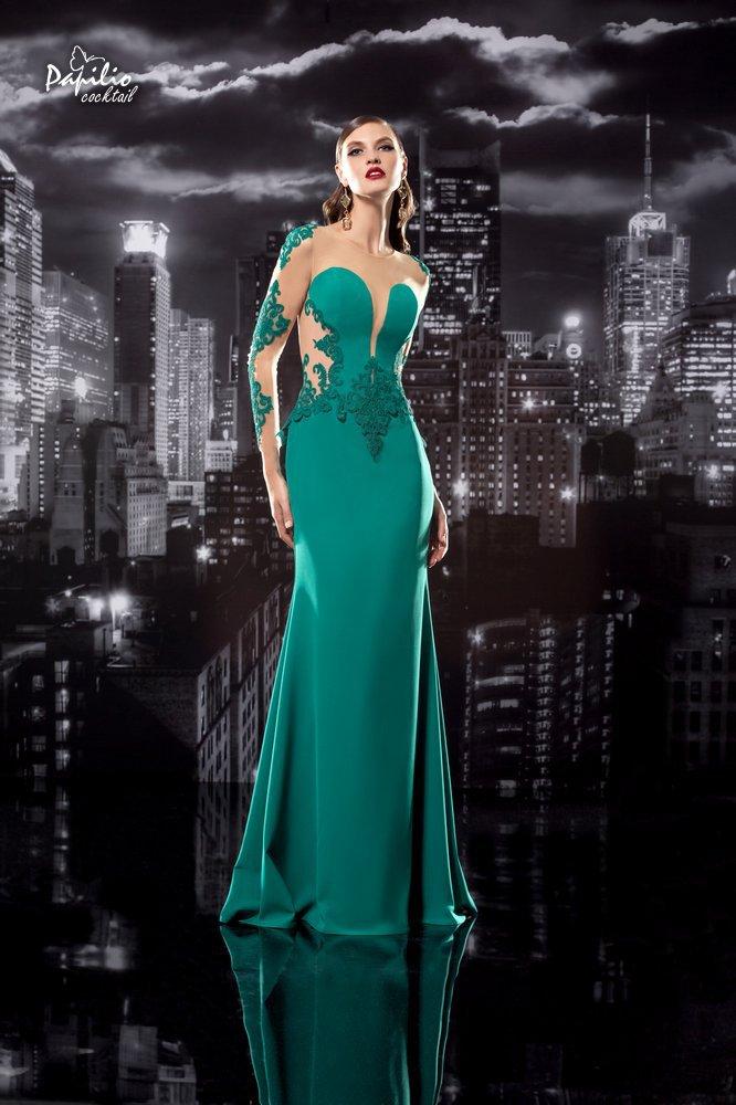 El color verde esmeralda adorna este vestido de fiesta