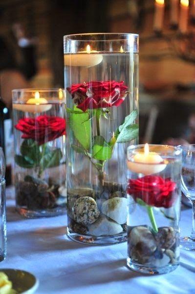 Centros de mesa con agua y velas